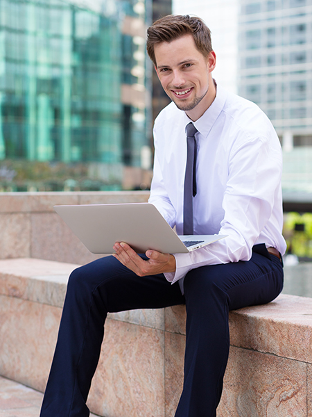Caucasian young businessman use of the notebook computer